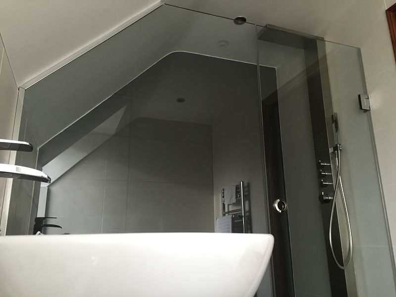 Loft and sloping ceiling frameless glass shower enclosure